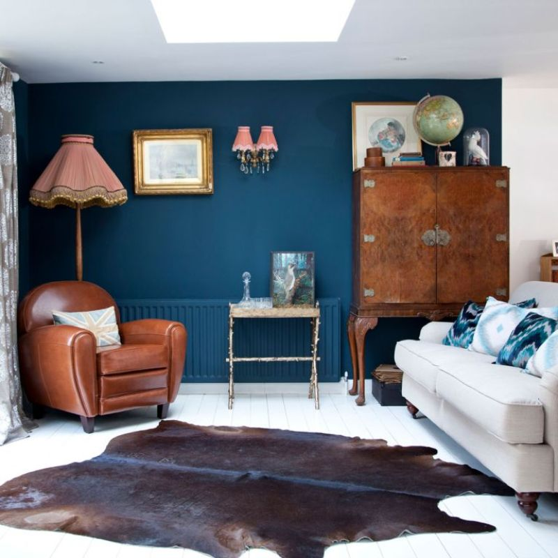 blue living room with wall lights