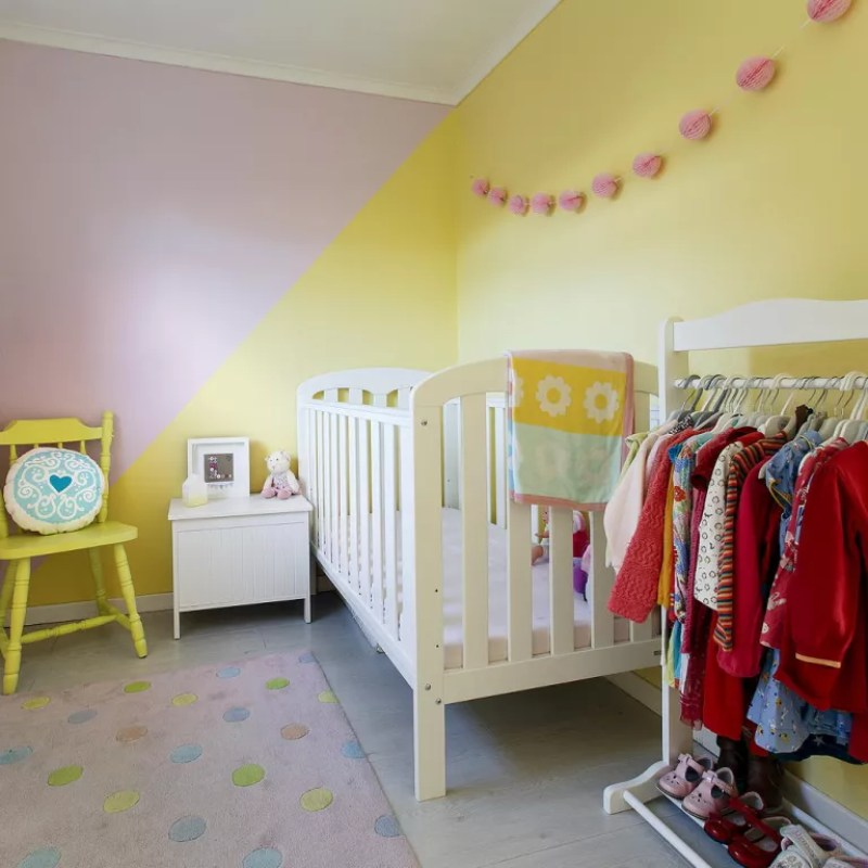 Nursery with pink and yellow walls