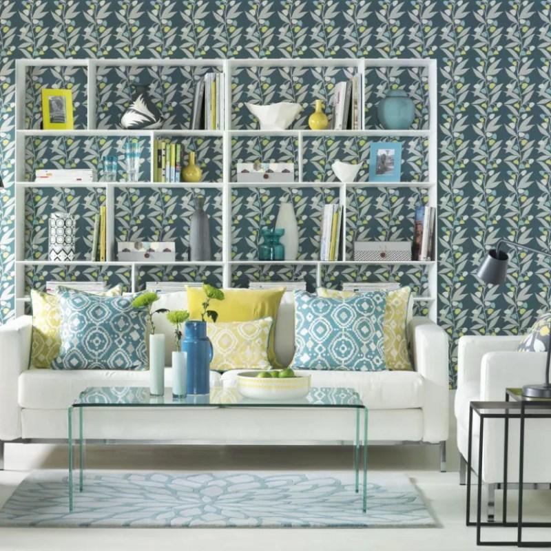 blue living room wallpaper with white bookshelf