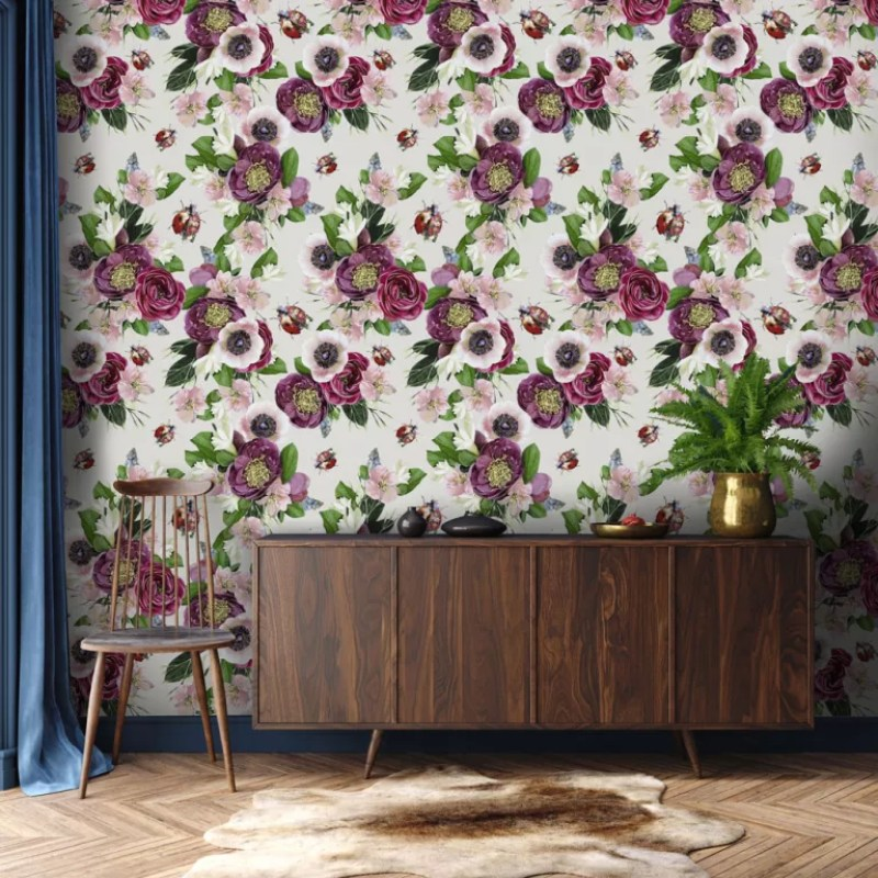 Floral wallpaper behind walnut wooden sideboard in living room