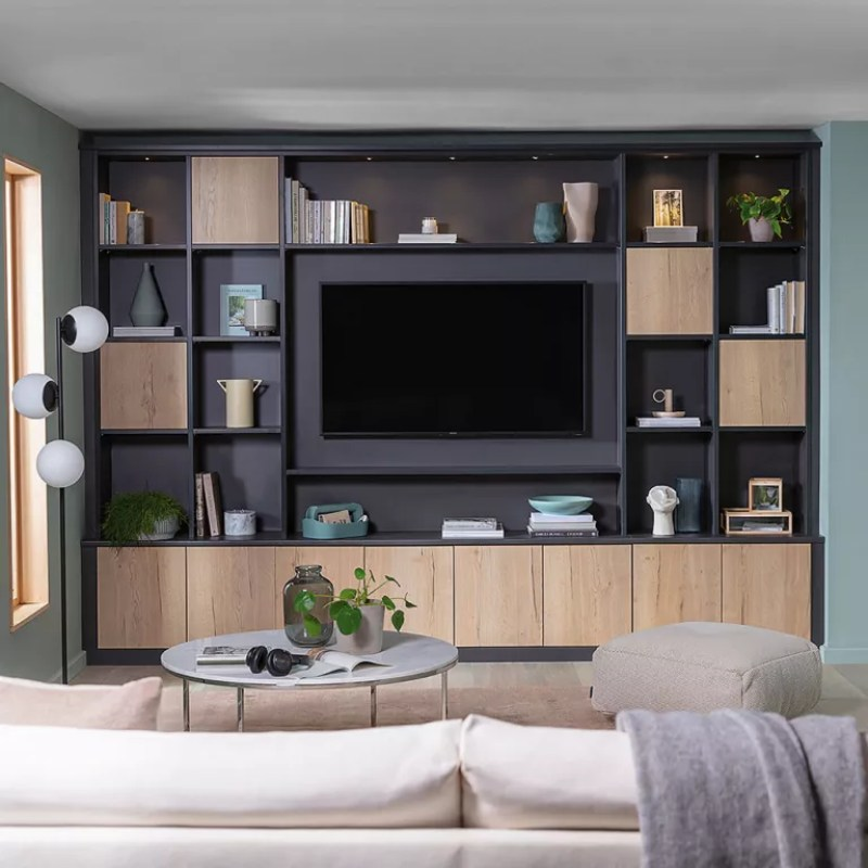 Living room with built in wall storage and TV at centre