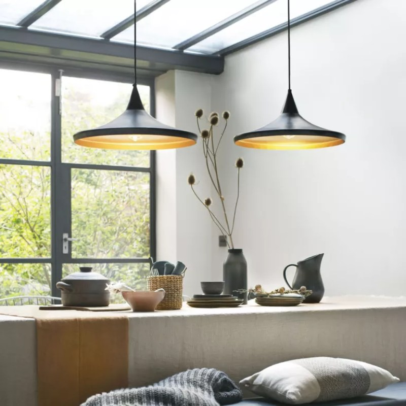 conservatory dining area with black pendant lights over table