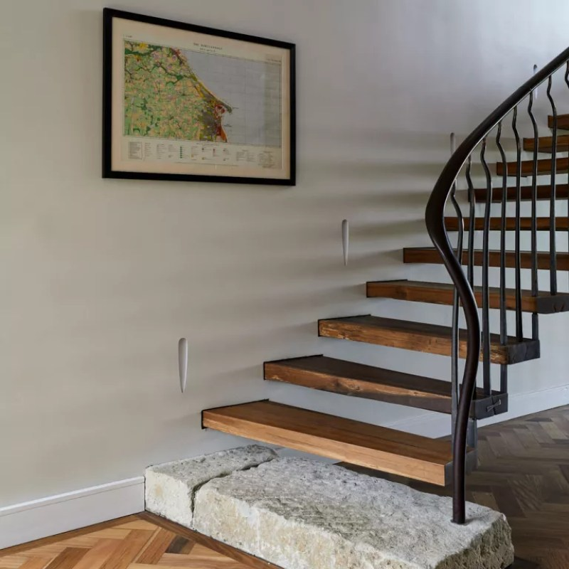 staircase with wooden treads and metal handrail