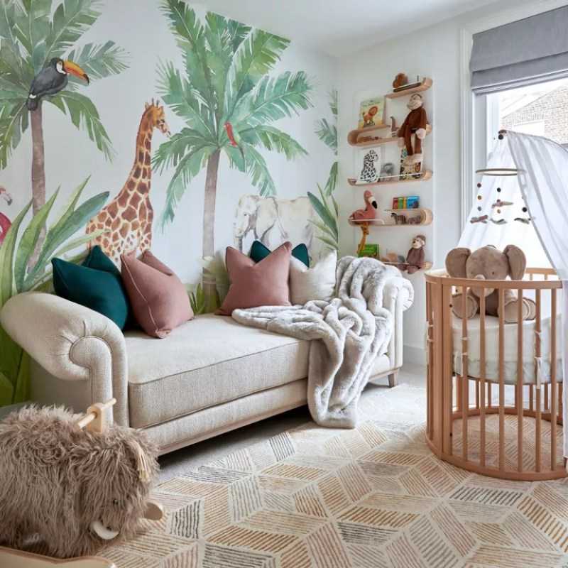 gender neutral nursery with safari and palm tree wall mural with chaise sofa