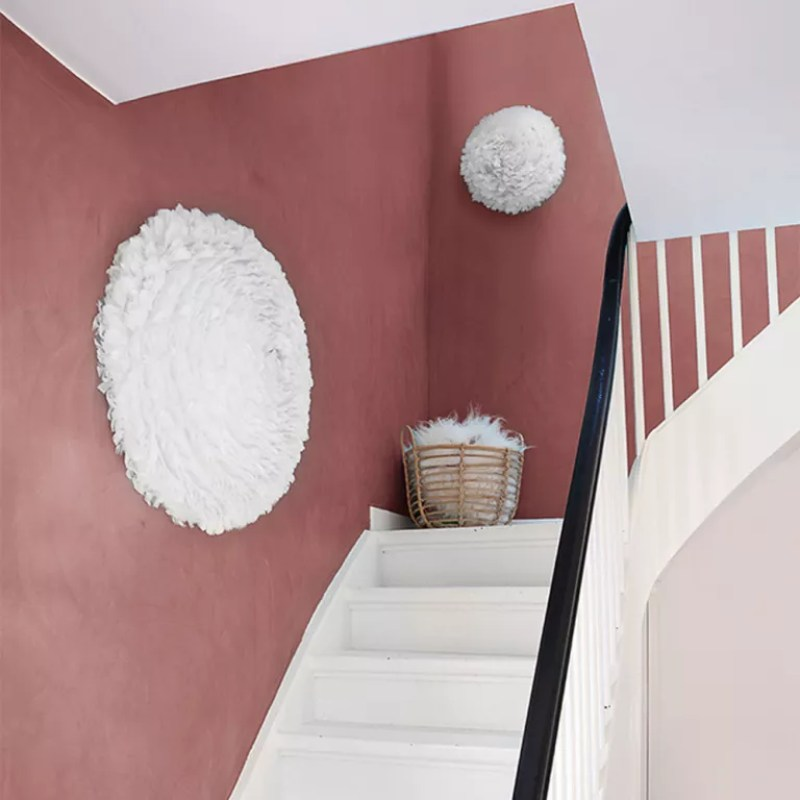 stairway lighting red walls and white pompom lights