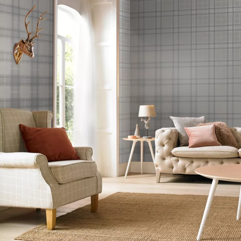 tartan wallpaper in a living room with stag head - graham and brown