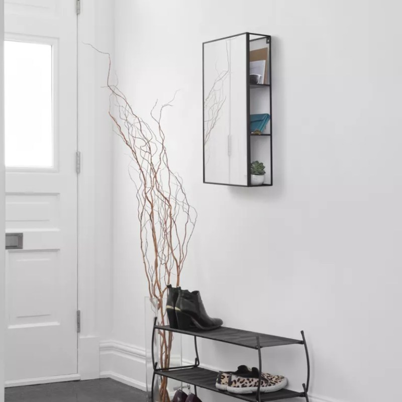 white hallway with mirror wall cabinet