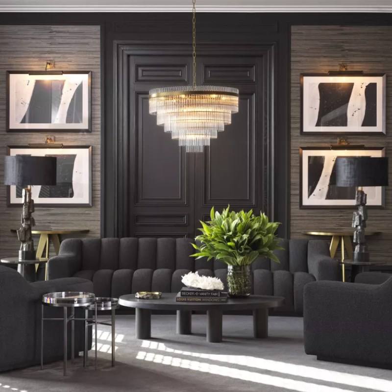 Living room with grey wallpapered walls and black painted doors and picture rails with black sofa and black armchairs