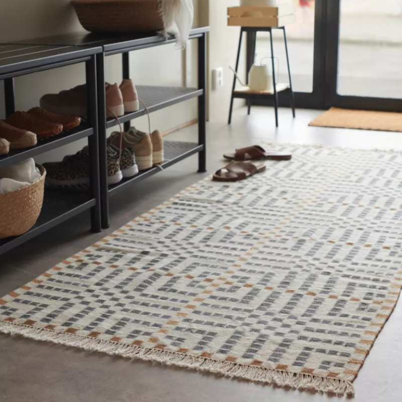 Hallway runner rug on grey tiled flooring