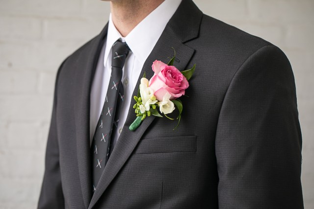 groom details. Lightsaber tie and boutonniere