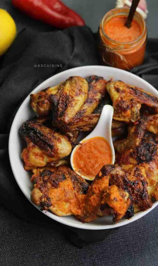 Chicken Piri Piri also known as peri peri chicken served with peri peri sauce