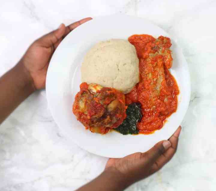 oat fufu served with ewedu and turkey stew