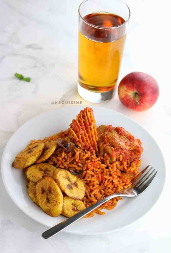 jollof rice served with plantain, and chicken