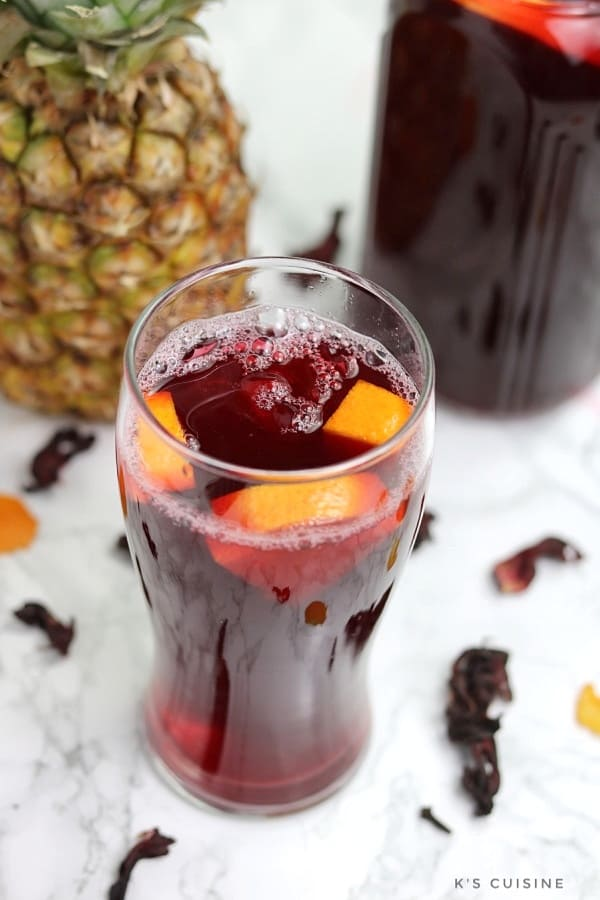 zobo drink in glass cup garnished with oranges