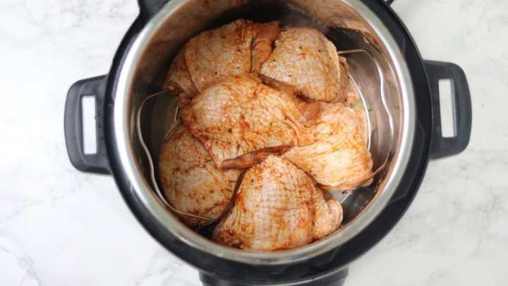 marinated chicken thighs arranged on trivet