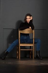 Beautiful dark hair model natural look posing with chair