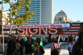 Protesters begin tearing down a banner welcoming President Obama to Oakland during a protest while the president was in town to raise money for his incumbent campaign July 23, 2012. Photo by Kevin Skahan.