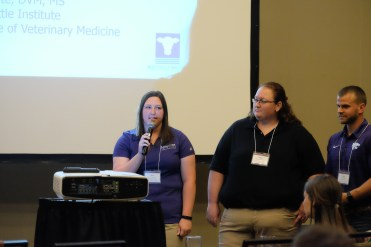 From left, Lena Fernkopf, Megan Westerhold and Jared Heiman during recognition at the 80th Annual Conference for Veterinarians June 3.