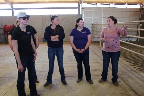 Dr. Tera Rooney-Barnhardt, coordinator of animal health and welfare at Cattle Empire LLC in Satanta, Kansas, talks with VTPRK students.