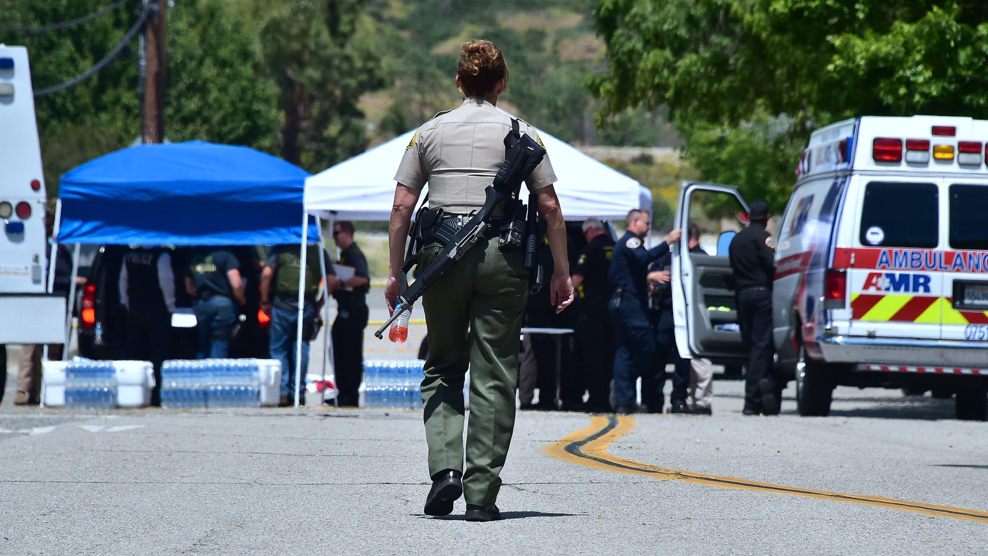 Law enforcement personnel are seen outside a closed-off North Park Elementary School in San Bernardino on April 10, 2017, following a shooting at the school. (Credit: Frederic J. Brown/AFP/Getty Images)