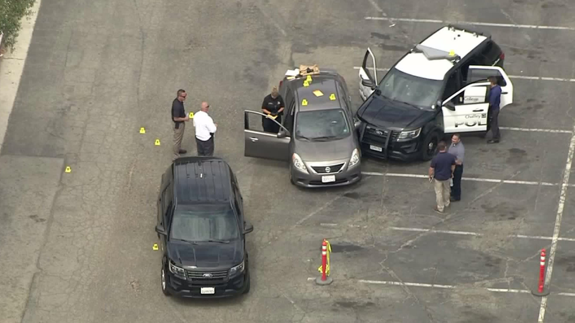 Evidence markers are seen on a car at Chaffey College on July 25, 2017. (Credit: KTLA)