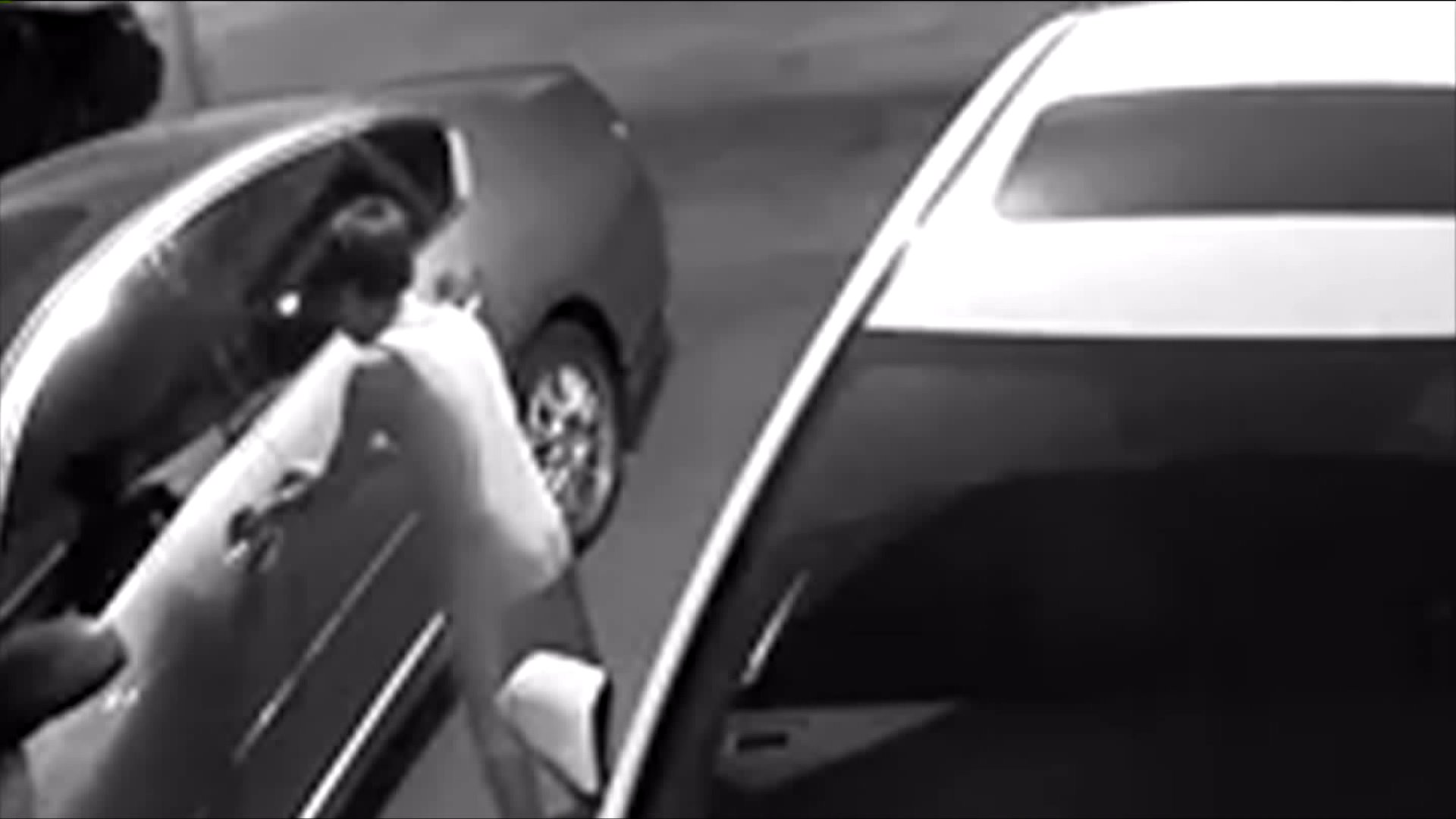 A still from security footage shows what appears to be a child trying to break into cars in South Gate. (Credit: KTLA)