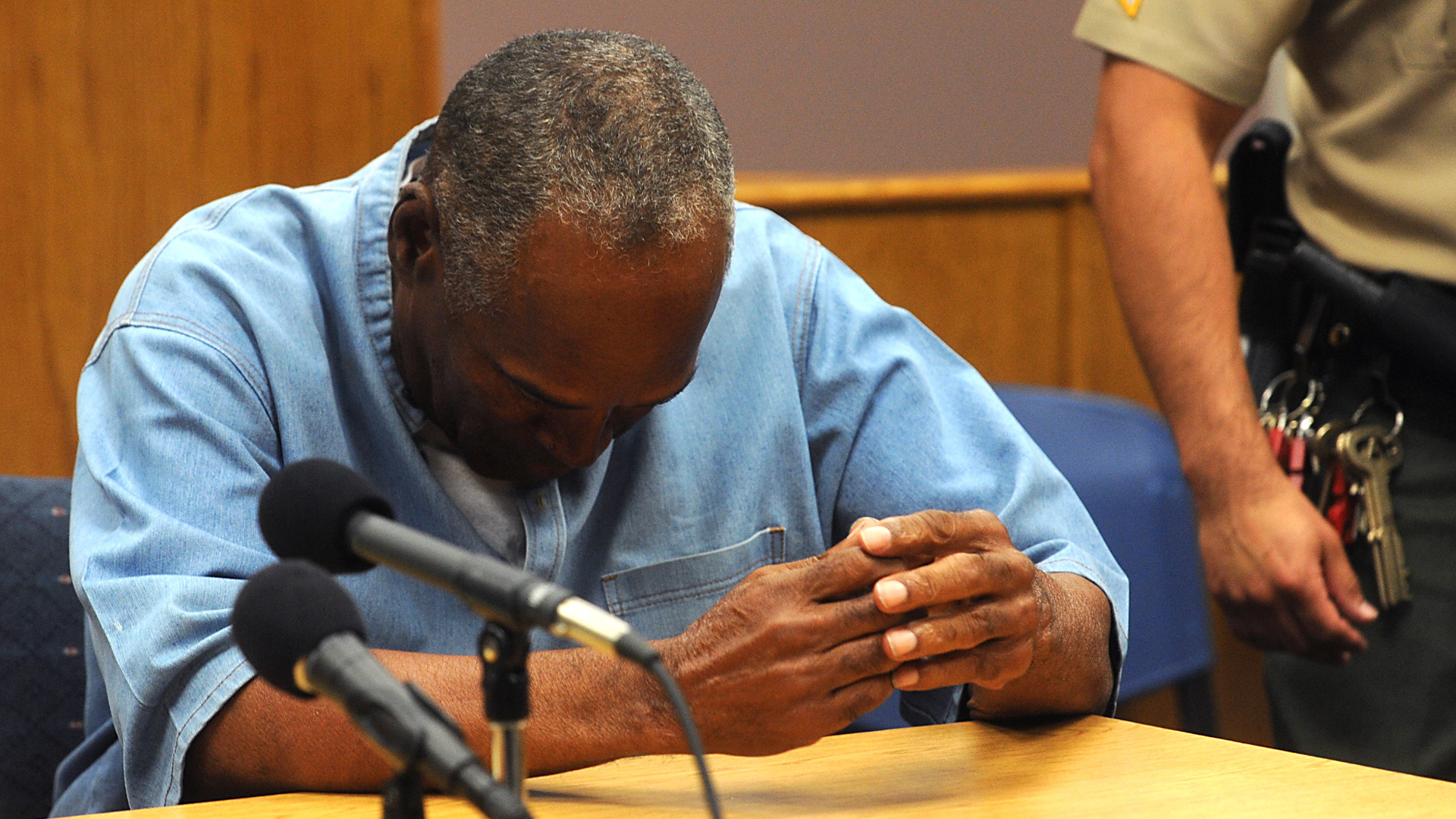 O.J. Simpson reacts after learning he was granted parole at Lovelock Correctional Center July 20, 2017 in Lovelock, Nevada. . (Credit: Jason Bean-Pool/Getty Images)
