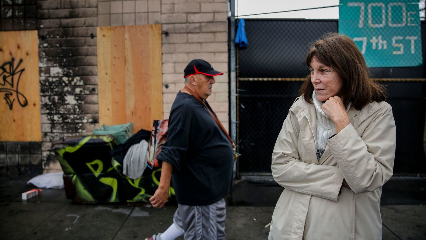 Lisa Rich stands outside her property on East 7th Street after a blaze engulfed a tent on skid row and spread to her warehouse in December 2017. (Credit: Jay L. Clendenin / Los Angeles Times)