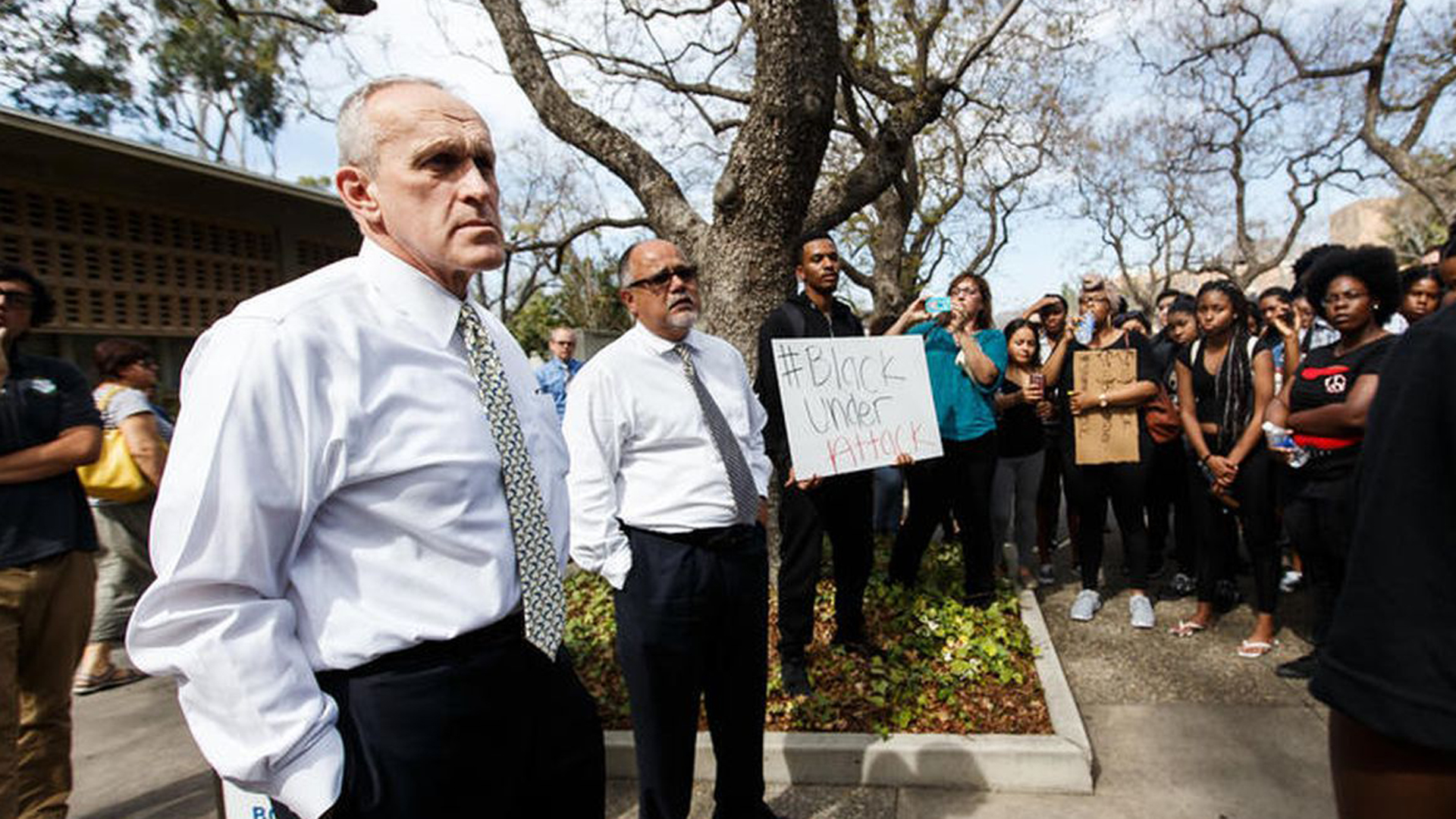 UC Riverside Chancellor Kim Wilcox, far left, is confronted by protesters against racial injustice and police brutality, including members of the Black Student Union. (Credit: Marcus Yam / Los Angeles Times)
