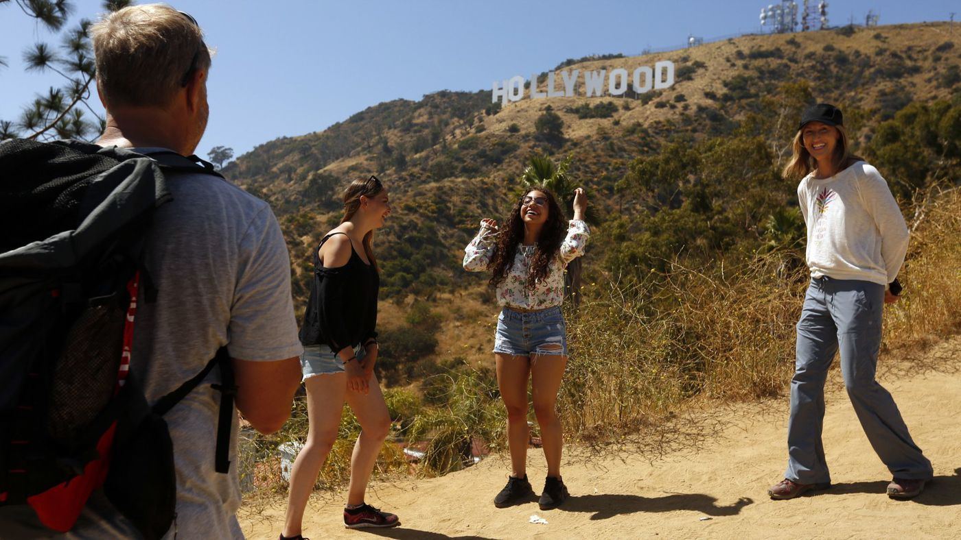Brian McCarthy, left, of Newport Beach, Linda Satoris of Germany, Bonita Getrouw of San Francisco and Brian's wife, Junette, stand near the Hollywood sign in this undated photo. (Credit: Genaro Molina / Los Angeles Times)