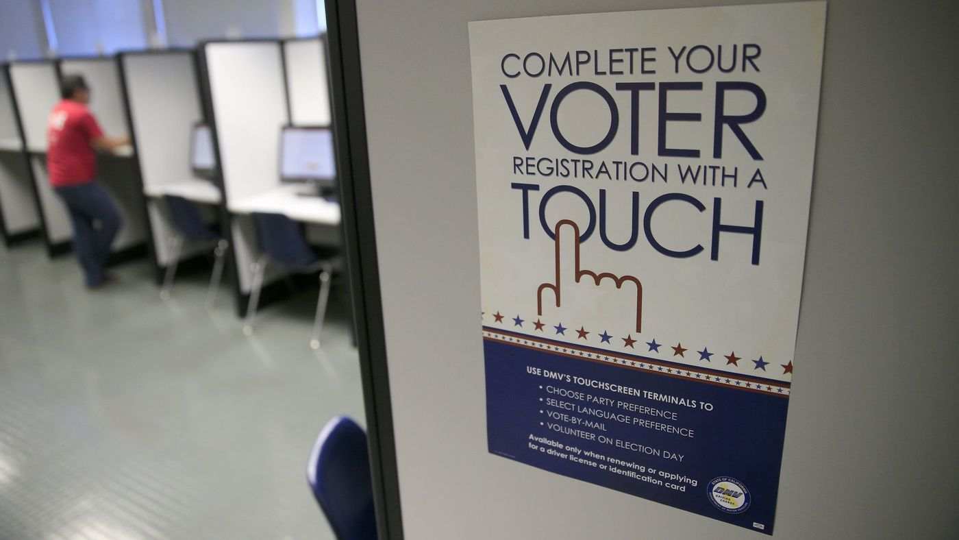A sign advertises a touch-screen machine, a new process for voter registration at the Department of Motor Vehicles in Santa Ana in this undated photo. (Credit: Allen J. Schaben / Los Angeles Times)
