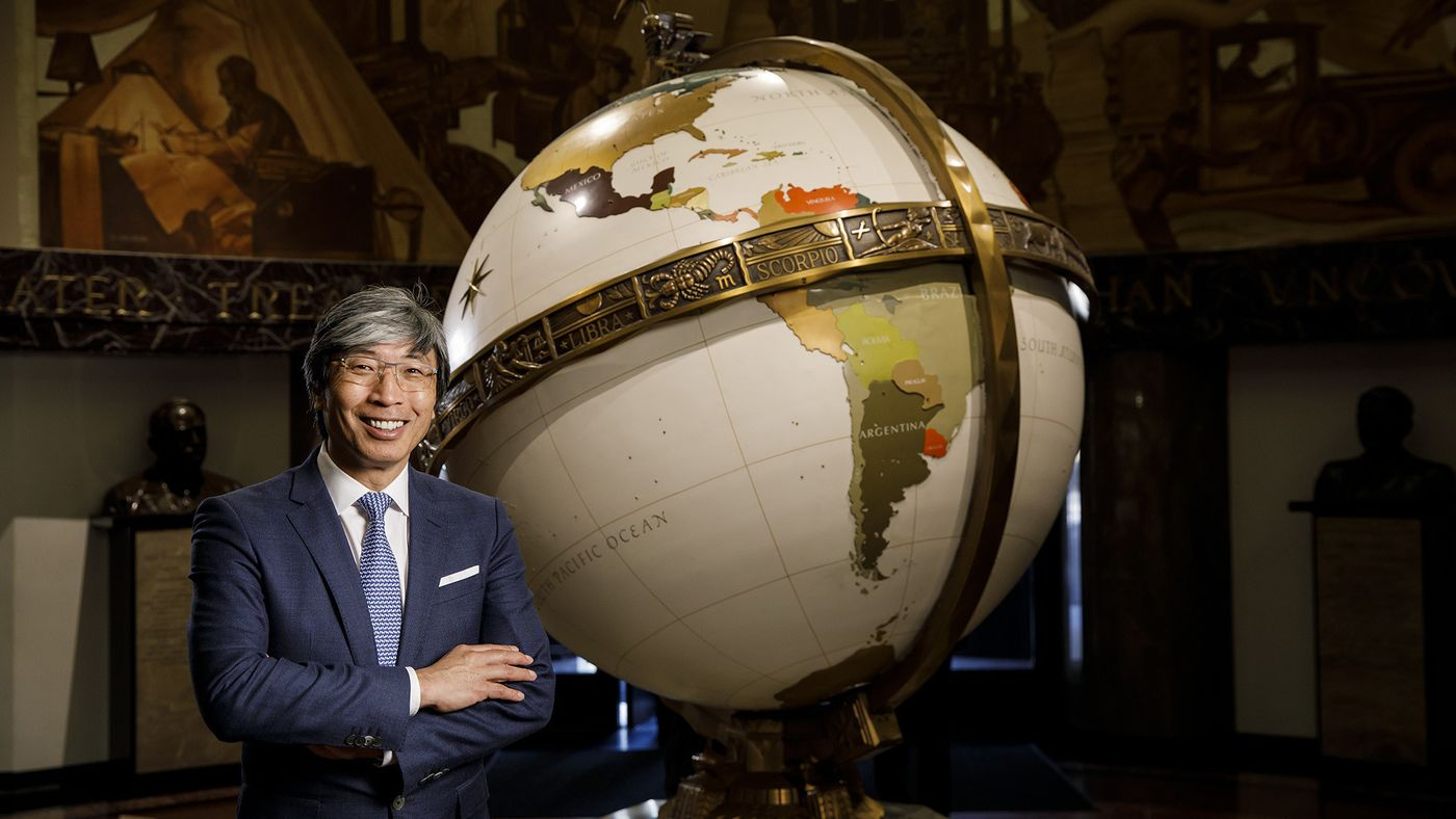 Dr. Patrick Soon-Shiong stands in front of a globe in an undated photo. (Credit: Marcus Yam / Los Angeles Times)