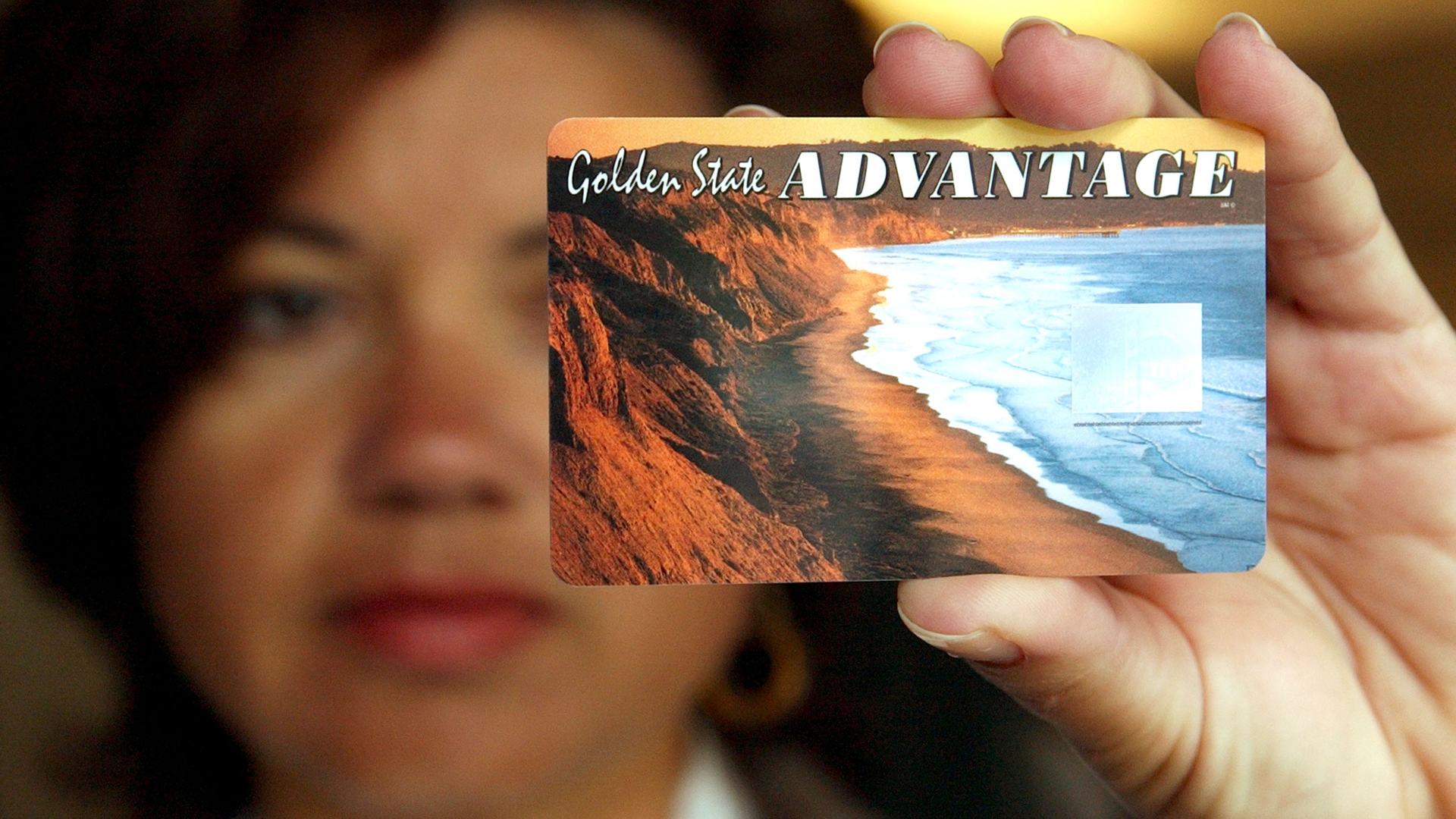 A woman holds a sample of the California State Electronic Benefit Transfer card on July 17, 2002, in Oakland, Calif. (Credit: Justin Sullivan/Getty Images)