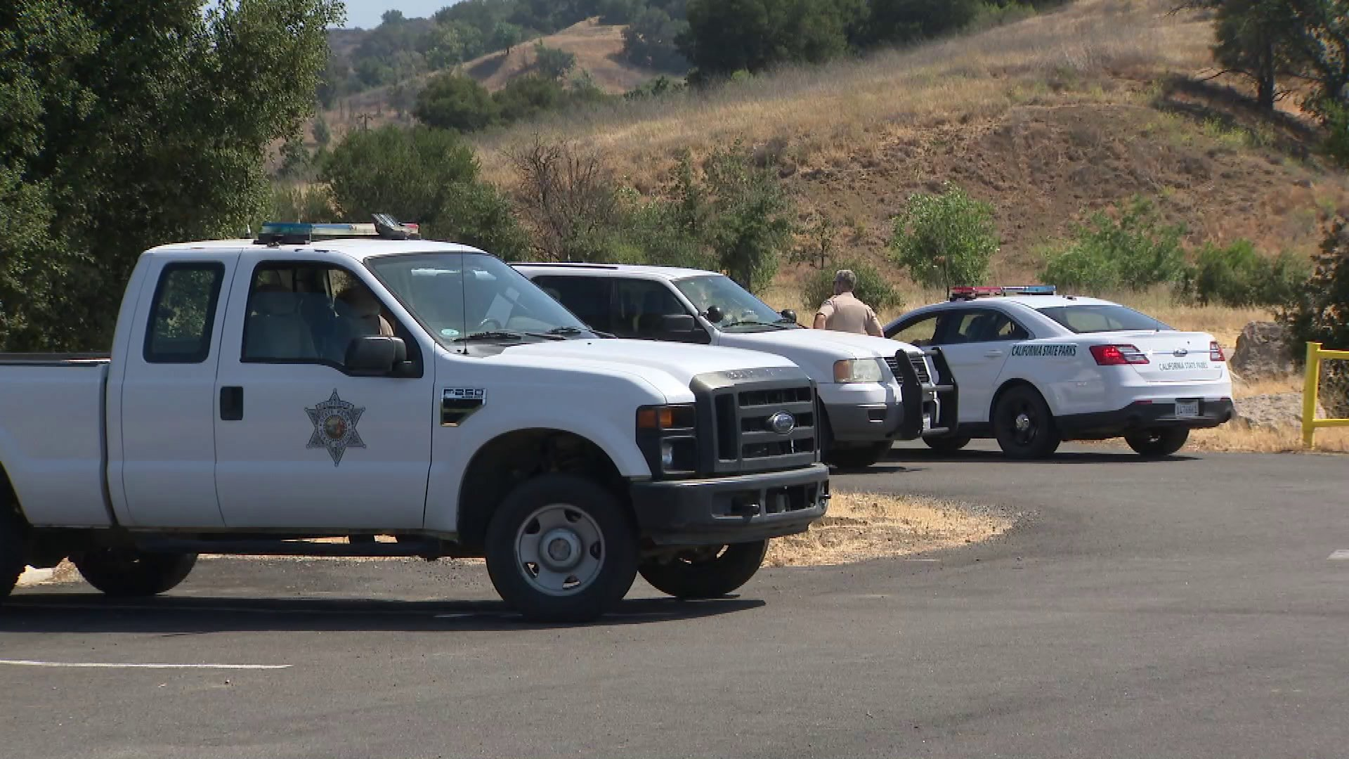 Authorities investigate the scene at Malibu Creek State Park where a father was shot while camping with his two young daughters on June 22, 2018. (Credit: KTLA)