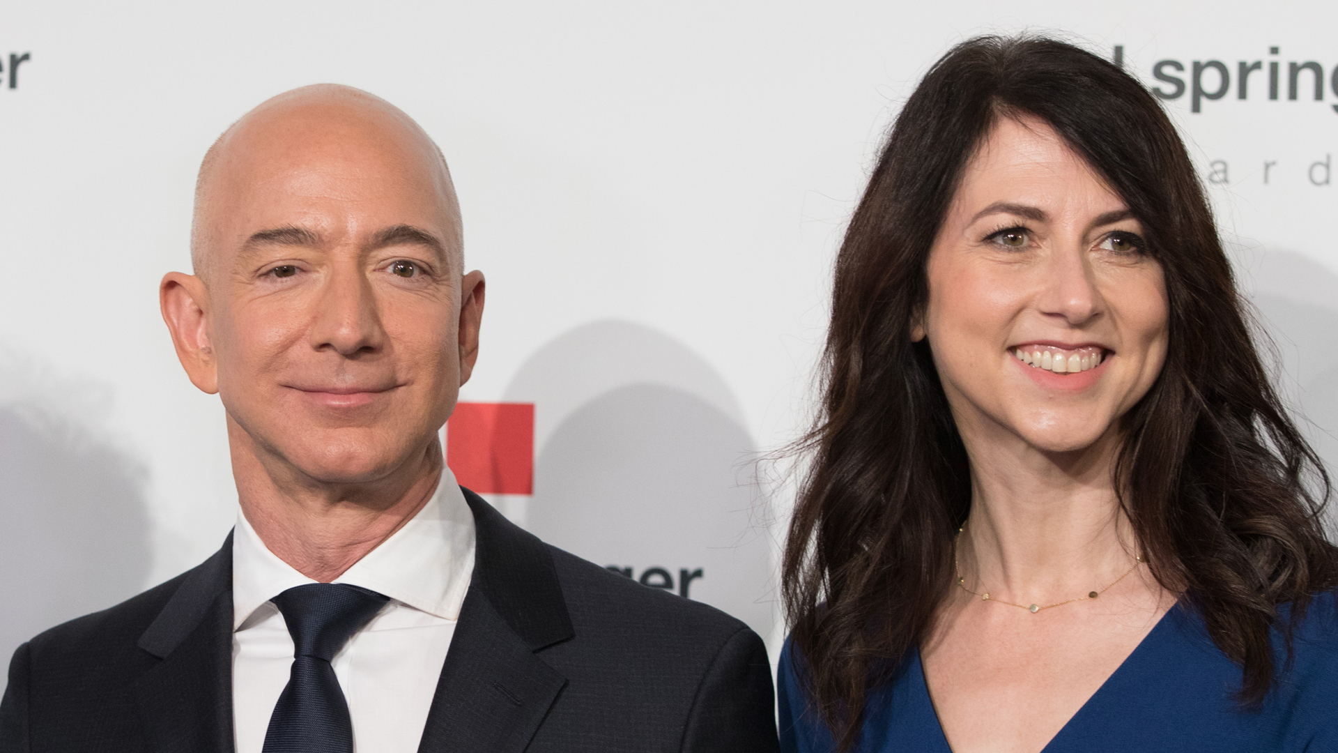 Amazon CEO Jeff Bezos and his wife MacKenzie Bezos arrive at the headquarters of publisher Axel-Springer on April 24, 2018, in Berlin, Germany. (Credit: JORG CARSTENSEN/AFP/Getty Images)