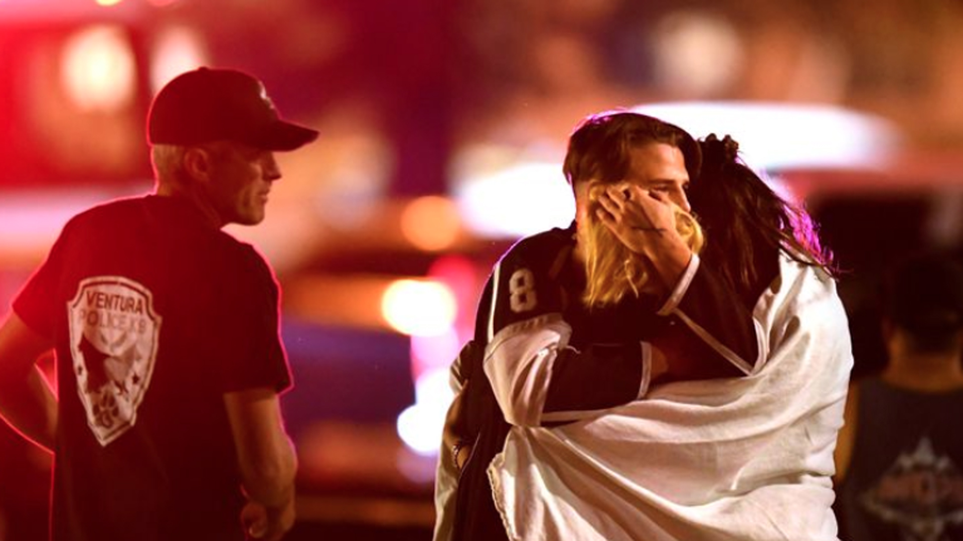 People comfort each other after a mass shooting at the Borderline Bar & Grill on Nov. 8, 2018. (Credit: Wally Skalij / Los Angeles Times)