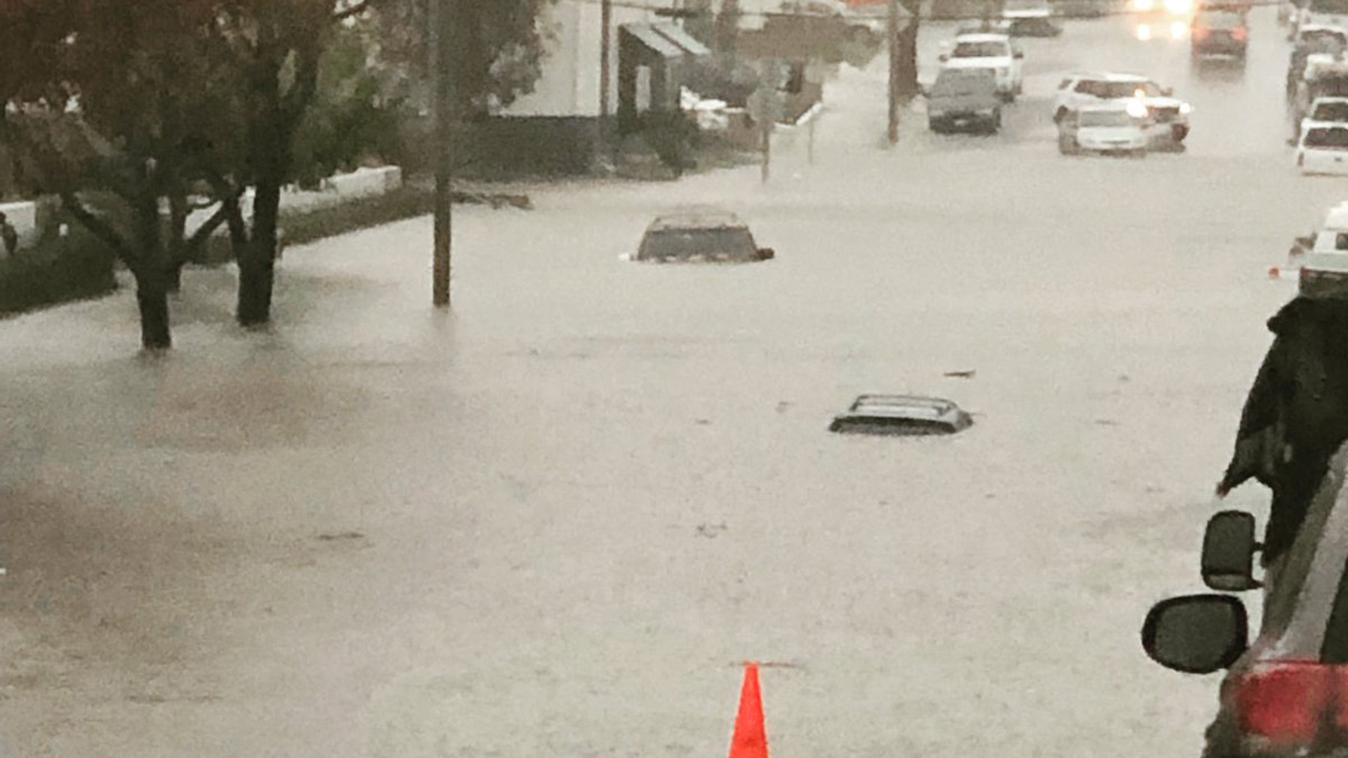 Water submerges cars at 17th Street and Pomona Avenue in Costa Mesa during a storm on Dec. 6, 2018. (Credit: Costa Mesa Police Department)