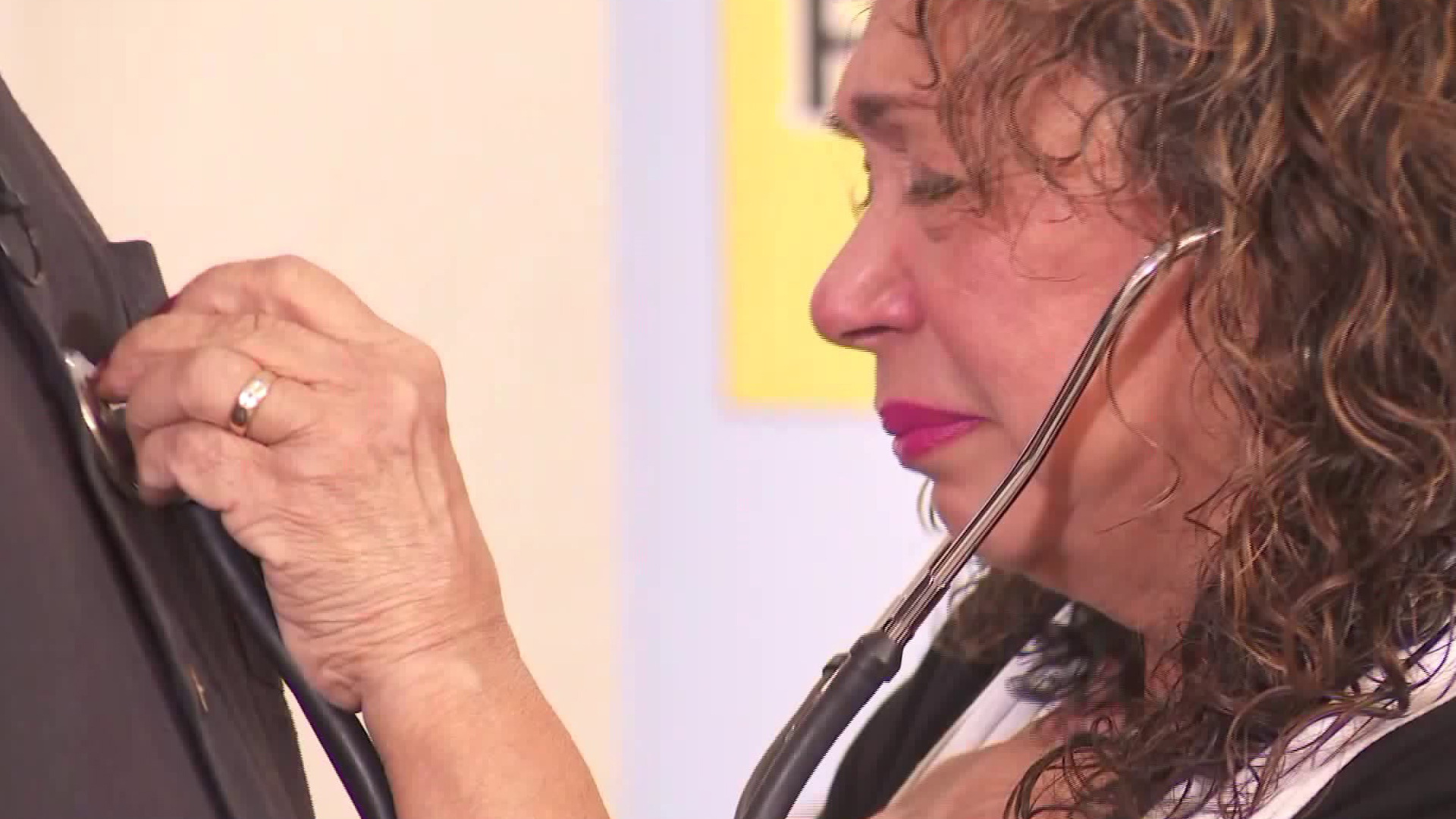 The mother of organ donor Herbert Alberts, Genny, listens to the sound of heartbeats coming from Jeff Eble in Pasadena on Dec. 30, 2018. Eble received her son's heart as a life-saving transplant.(Credit: KTLA)