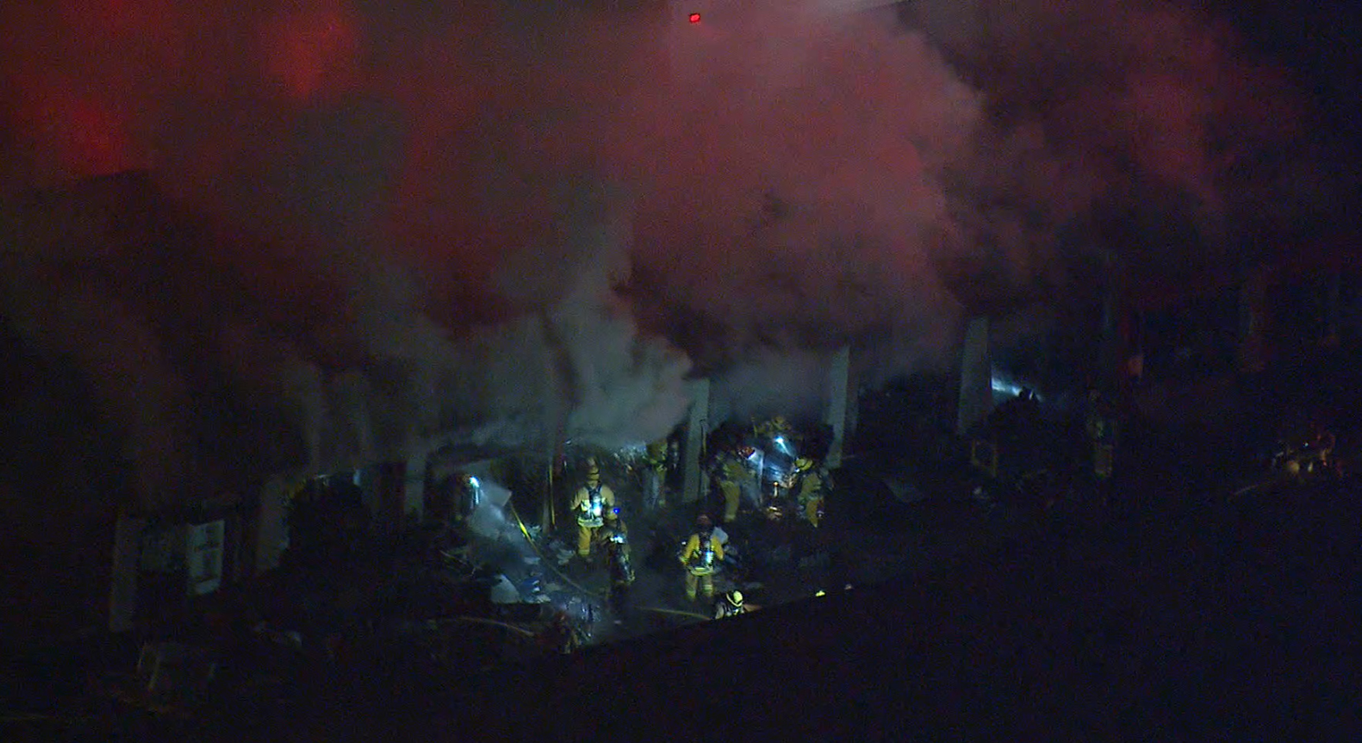 Crews work to put out a blaze that erupted at a storage facility in Valencia on Jan. 7, 2018. (Credit: KTLA)