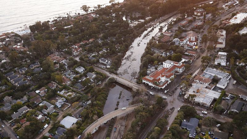 In January 2018, mud and debris clog up the 101 Freeway at the Olive Mill Road overpass in Montecito, after an onslaught of deadly mudslides. (Credit: Al Seib / Los Angeles Times)