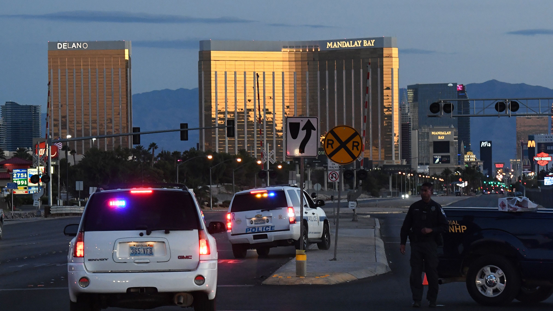 Police form a perimeter around the road leading to the Mandalay Hotel (background) after a gunman killed at least 50 people and wounded more than 400 others when he opened fire on a country music concert in Las Vegas, Nevada on October 2, 2017. (Credit: MARK RALSTON/AFP/Getty Images)