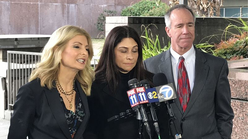 LAPD Det. Ysabel Villegas, center, and her attorney, Lisa Bloom, left, outside a Los Angeles courtroom on Jan. 15, 2019. (Credit: James Queally / Los Angeles Times)