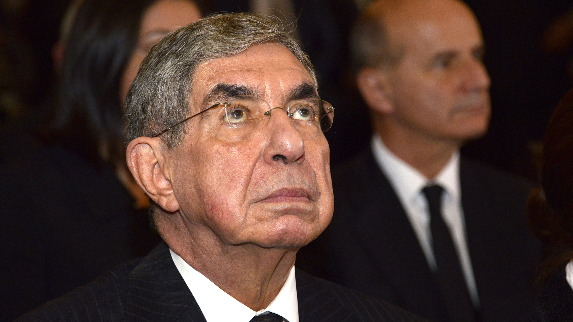 Nobel Peace Prize-winner and former Costa Rican president Oscar Arias Sanchez (1986-1990), (2006-2010) is seen during the funeral of former president Luis Alberto Monge (1982-1986) in the metropolitan cathedral of San Jose on Dec. 1, 2016.(Credit: EZEQUIEL BECERRA/AFP/Getty Images)