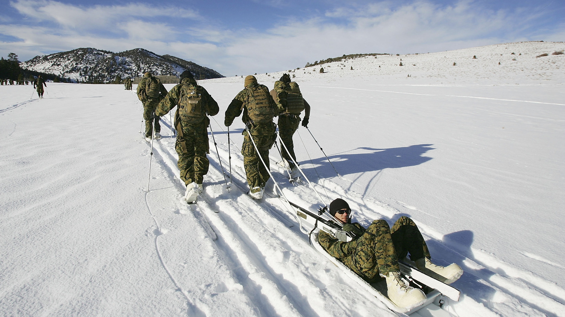 Marines learn to evacuate casualties using sleds and skis during training for winter conditions at the Marine Mountain Warfare Training Center on Dec. 9, 2005, near Bridgeport. (Credit: David McNew/Getty Images)