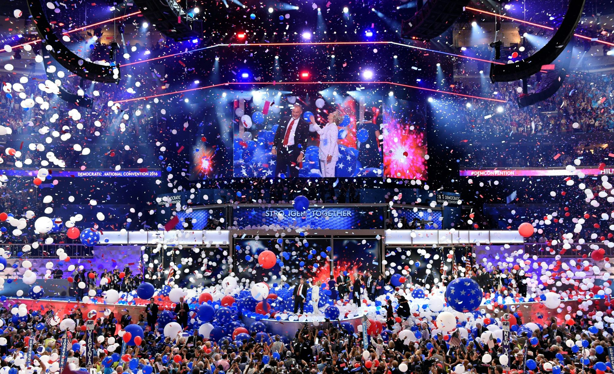 Balloons come down on Democratic presidential nominee Hillary Clinton and running mate Tim Kaine at the end of the fourth and final night of the Democratic National Convention at Wells Fargo Center on July 28, 2016, in Philadelphia, Penn. (Credit: SAUL LOEB/AFP/Getty Images)