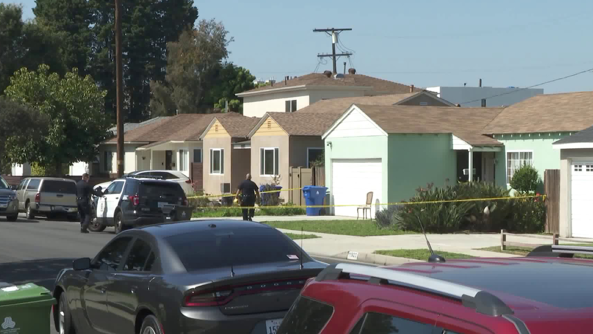 Police investigate at a home in Del Rey after a woman was found fatally burned in a bathtub. (Credit: KTLA)
