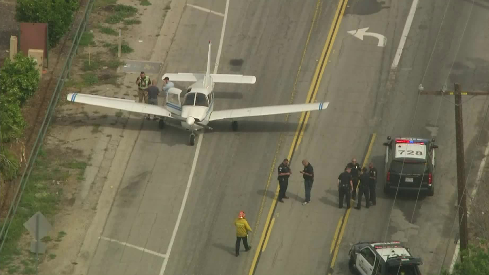 A small plane landed on a street near the Long Beach Airport on April 1, 2019. (Credit: KTLA)