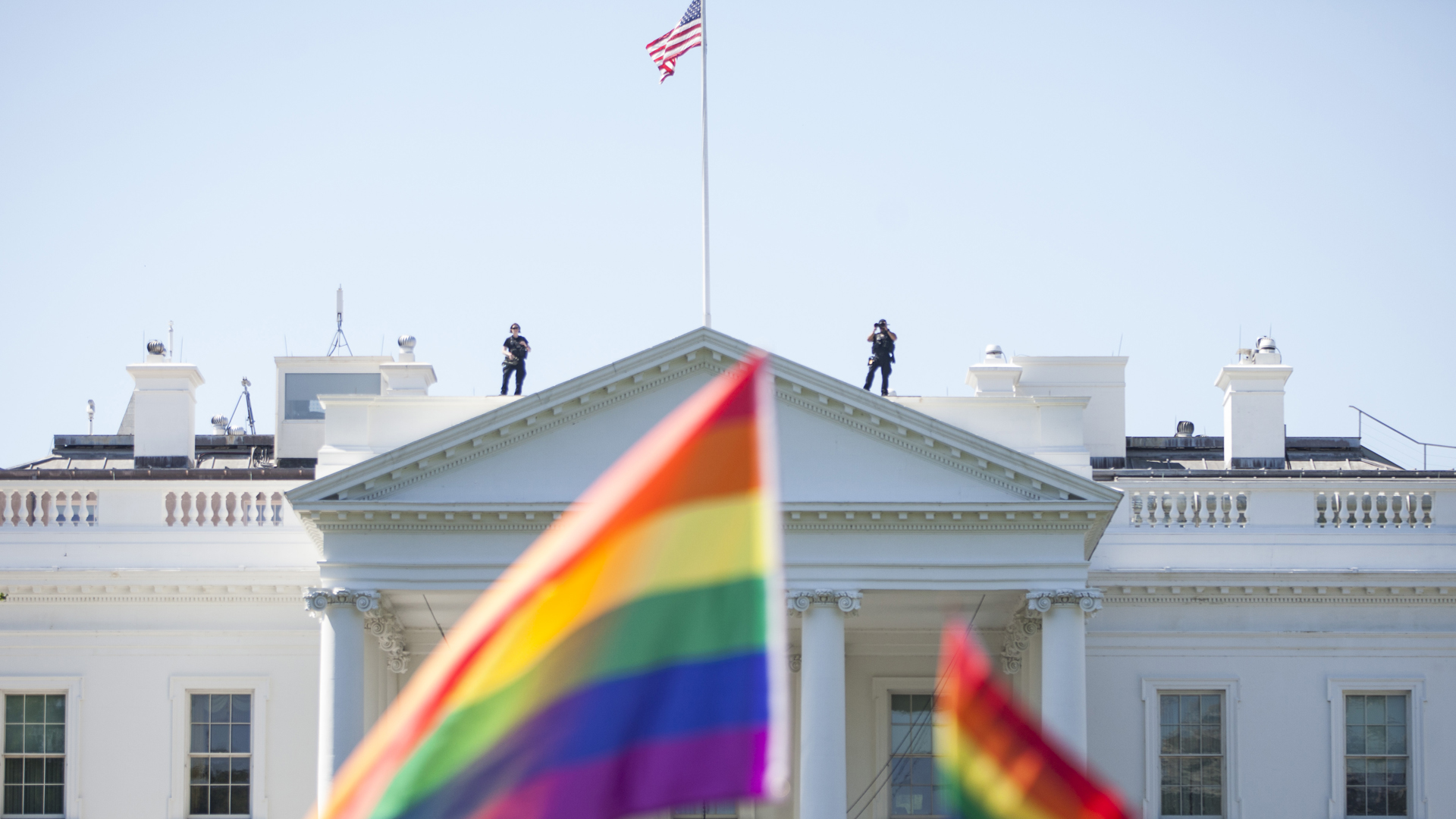 Demonstrators carry rainbow flags past the White House during the Equality March for Unity and Peace on June 11, 2017. in Washington, D.C. (Credit: Zach Gibson/Getty Images)