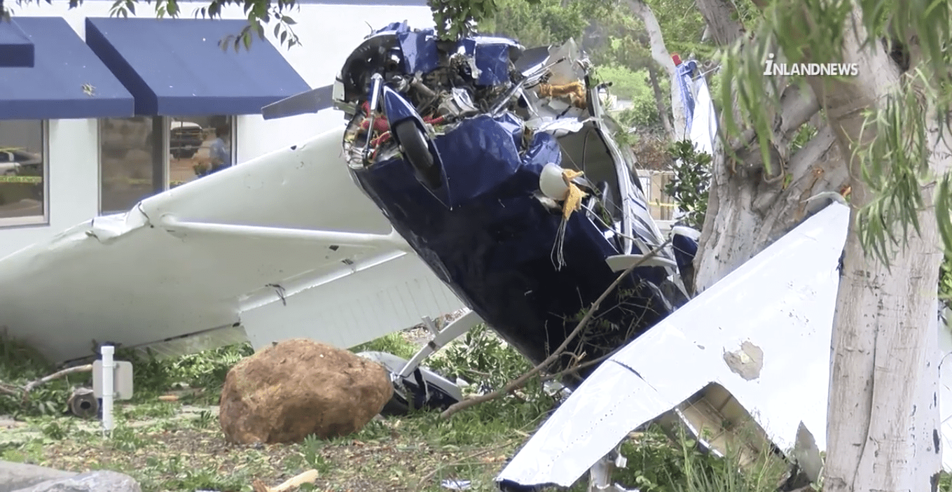 A small plane crash is seen in this image taken from video at the scene. (Credit: INLANDNEWS)