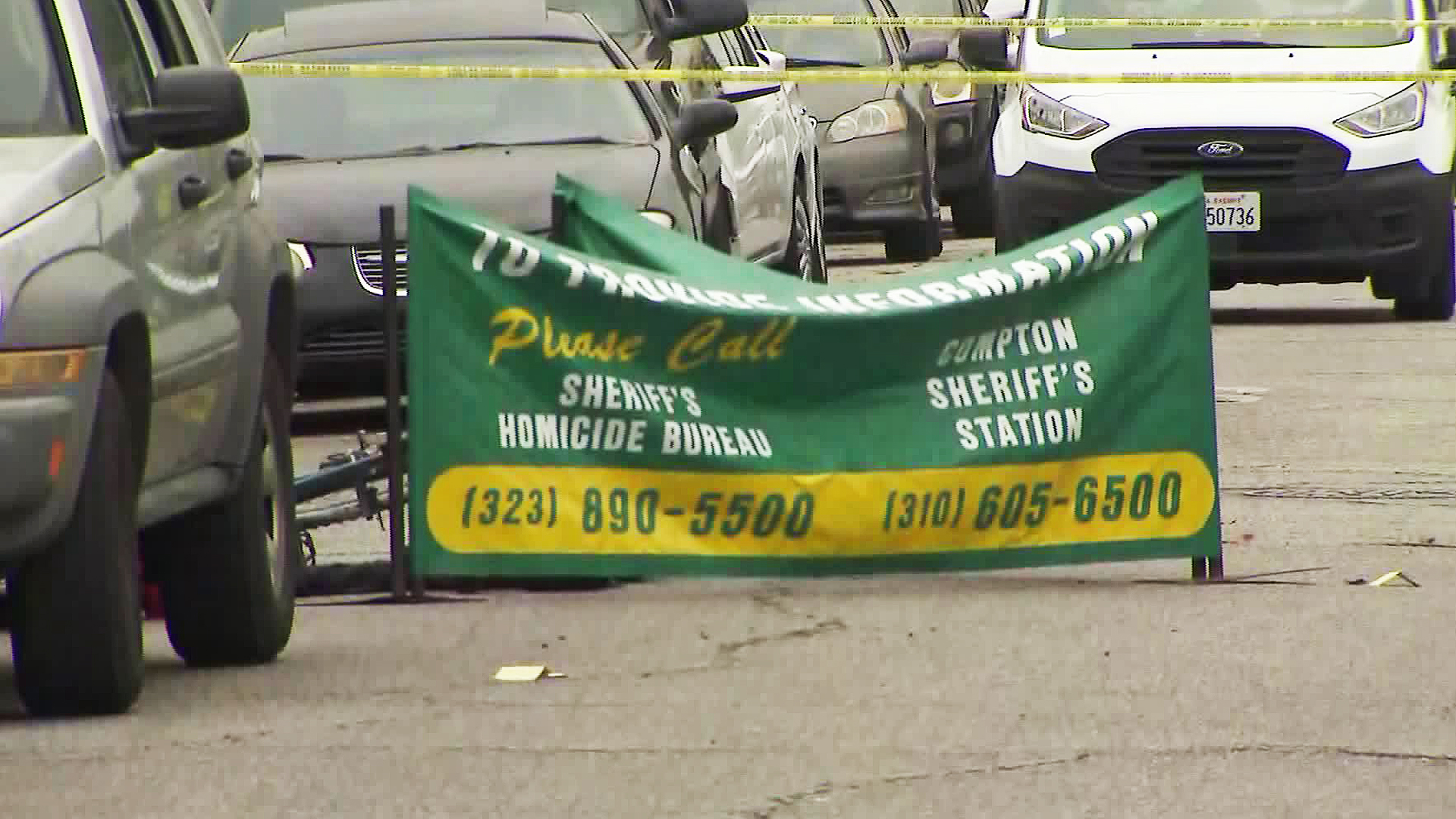 A body was found on a street in Compton following a shootout on July 3, 2019. (Credit: KTLA)
